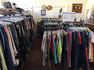 Clothing racks at VTC Thrift Store